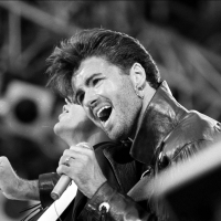 George Michael on stage for Wham's London concert in 1986